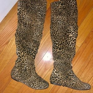 Knee high cheetah boots